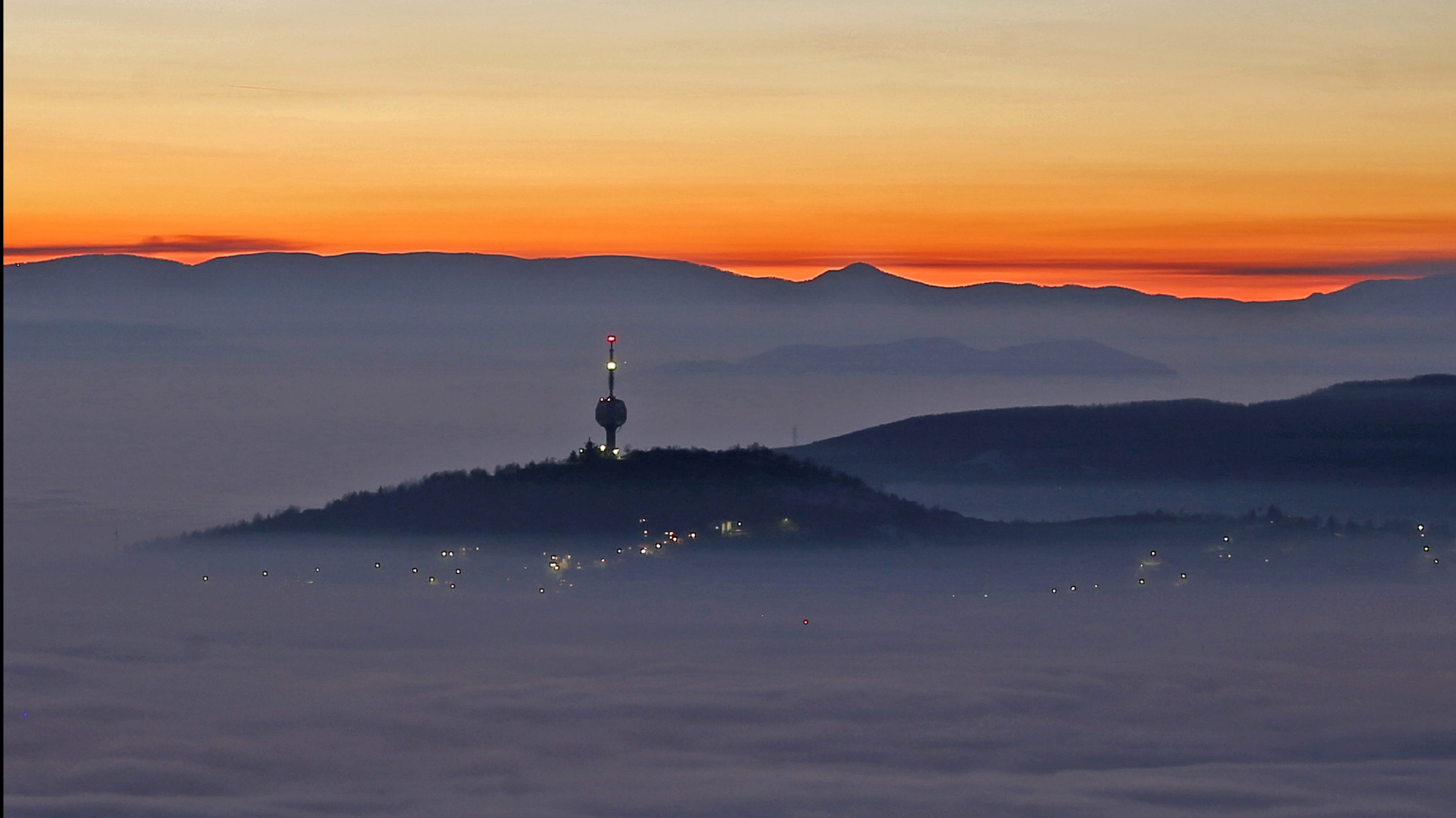 A TV tower is seen as smog blankets Sarajevo