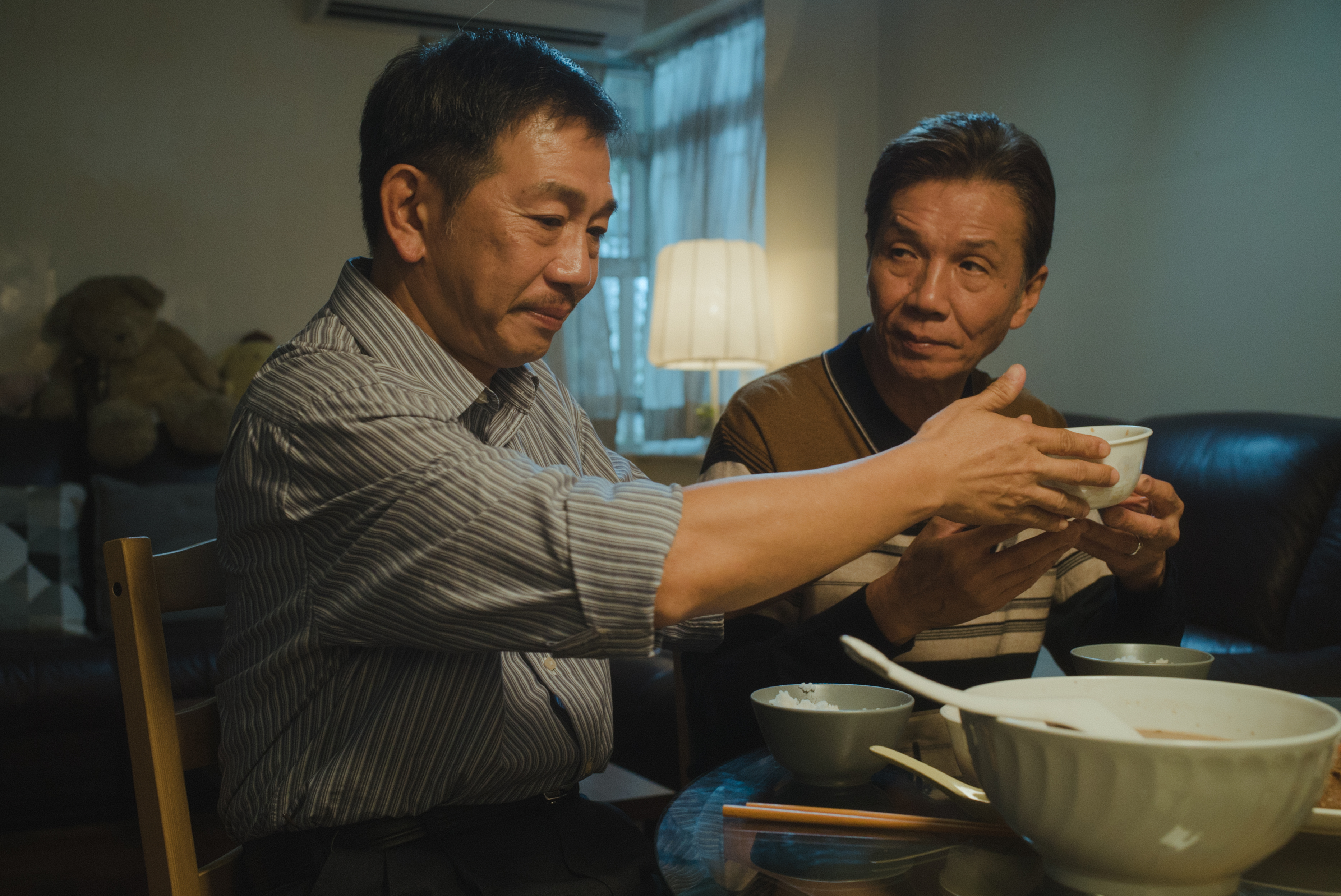 Elderly gay lovers Pak (right) and Hoi share a dinner together in 'Suk Suk'.