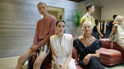 A young man, a young woman, and one silver-haired older woman pose at Rachel Comey's New York Fashion Week presentation in September 2016.