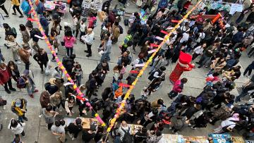 "An independent Lunar New Year gift bazaar on Centre Street in Hong Kong's Sai Ying Pun areas is part of the protest movement's ""yellow economic circle,"" Jan. 19, 2020."