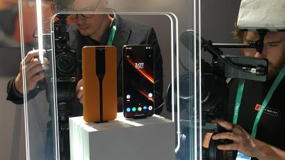Photographers take pictures and video of the Concept One at CES 2020.
