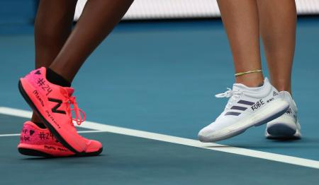 Tennis players Coco Gauff, left, and compatriot Caty McNally wear a tribute to Kobe Bryant on their shoes.