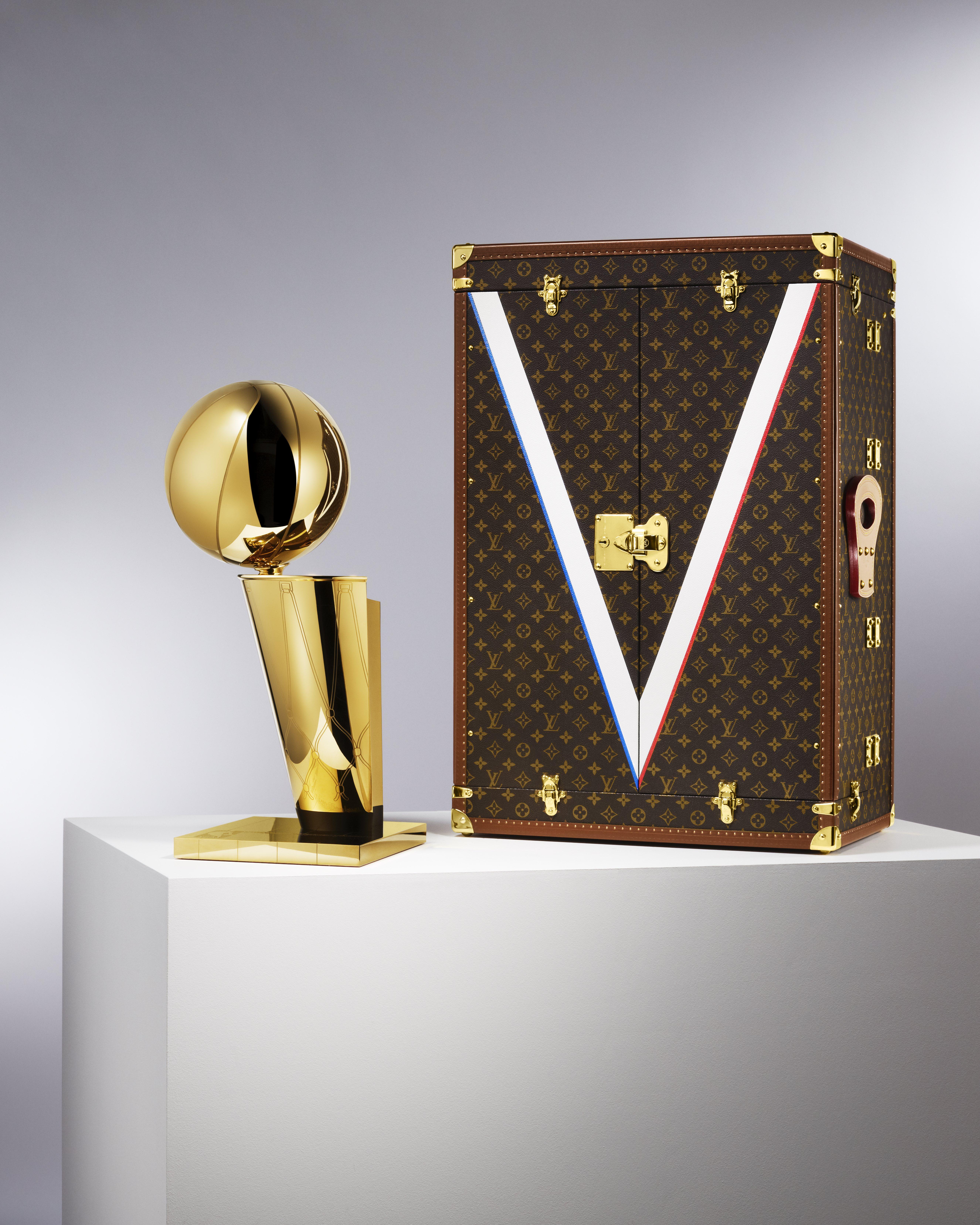 Louis Vuitton's travel case next to the NBA's championship trophy