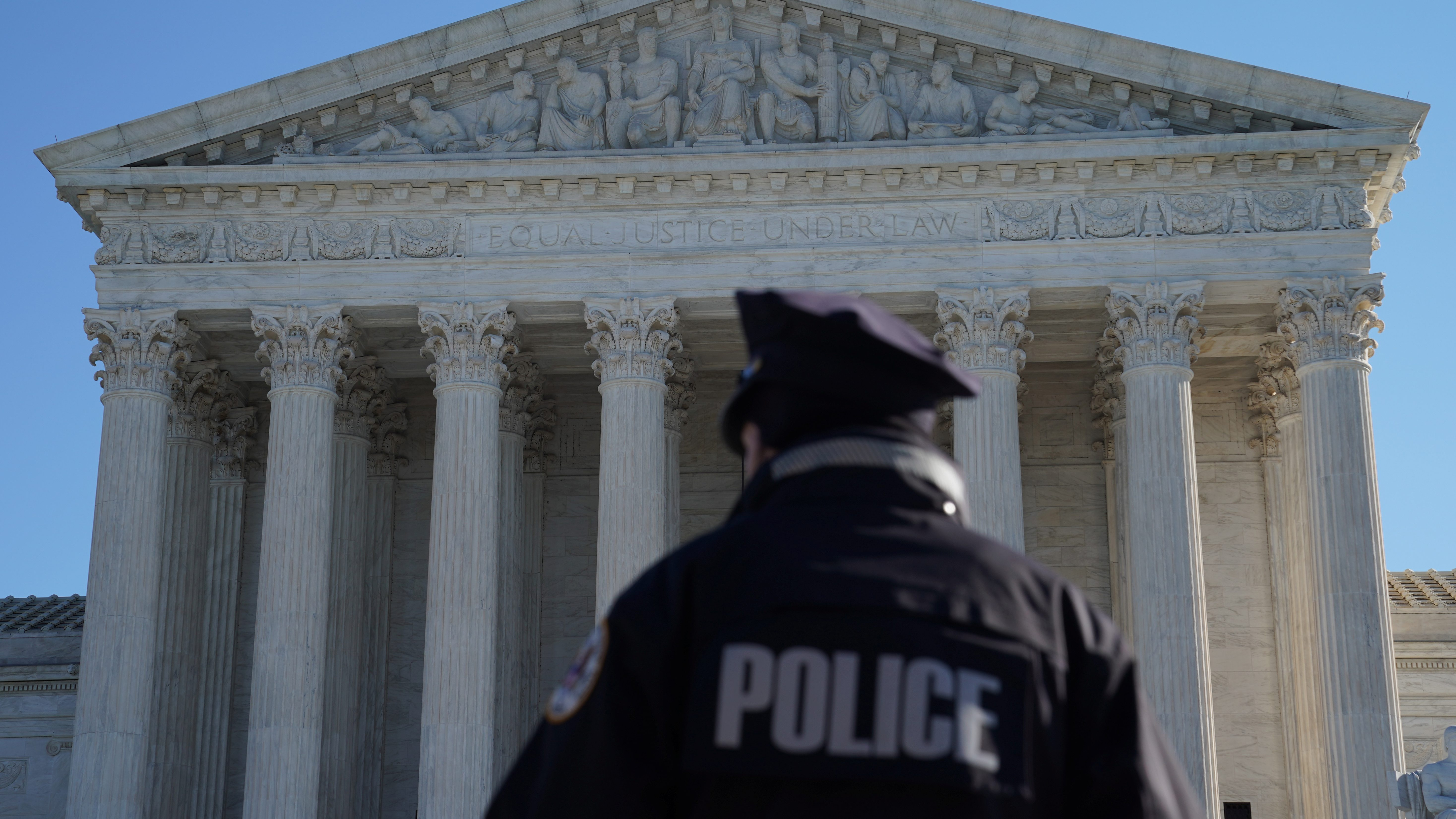 A police officer in front of the Supreme Court