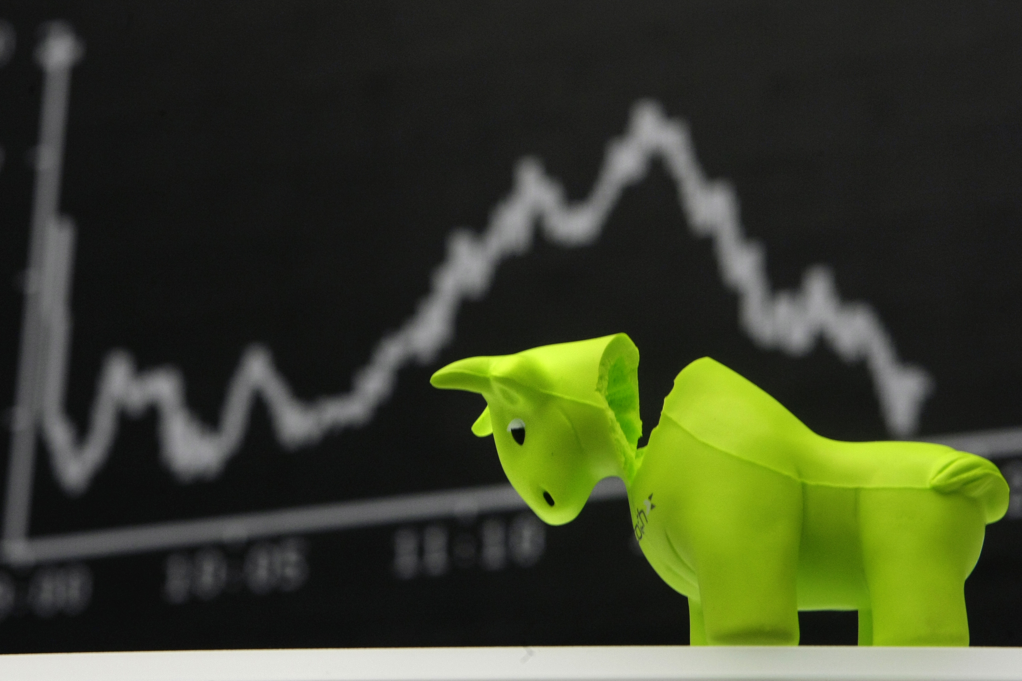 A bull styrofoam figure is pictured in front of the DAX board at the Frankfurt stock exchange.
