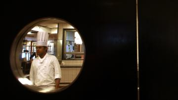 "A chef is seen in a kitchen of ""Frangipani"" restaurant in Trident-Oberoi hotel in Mumbai"