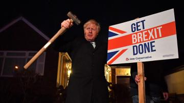 "Britain's Prime Minister and Conservative party leader Boris Johnson poses with a sledgehammer, after hammering a ""Get Brexit Done"" sign into the garden of a supporter, in South Benfleet, Britain December 11, 2019."