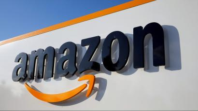 Amazon's logo is seen at one of its logistics centers