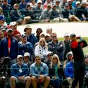 A crowd behind Tiger Woods at a golf event.