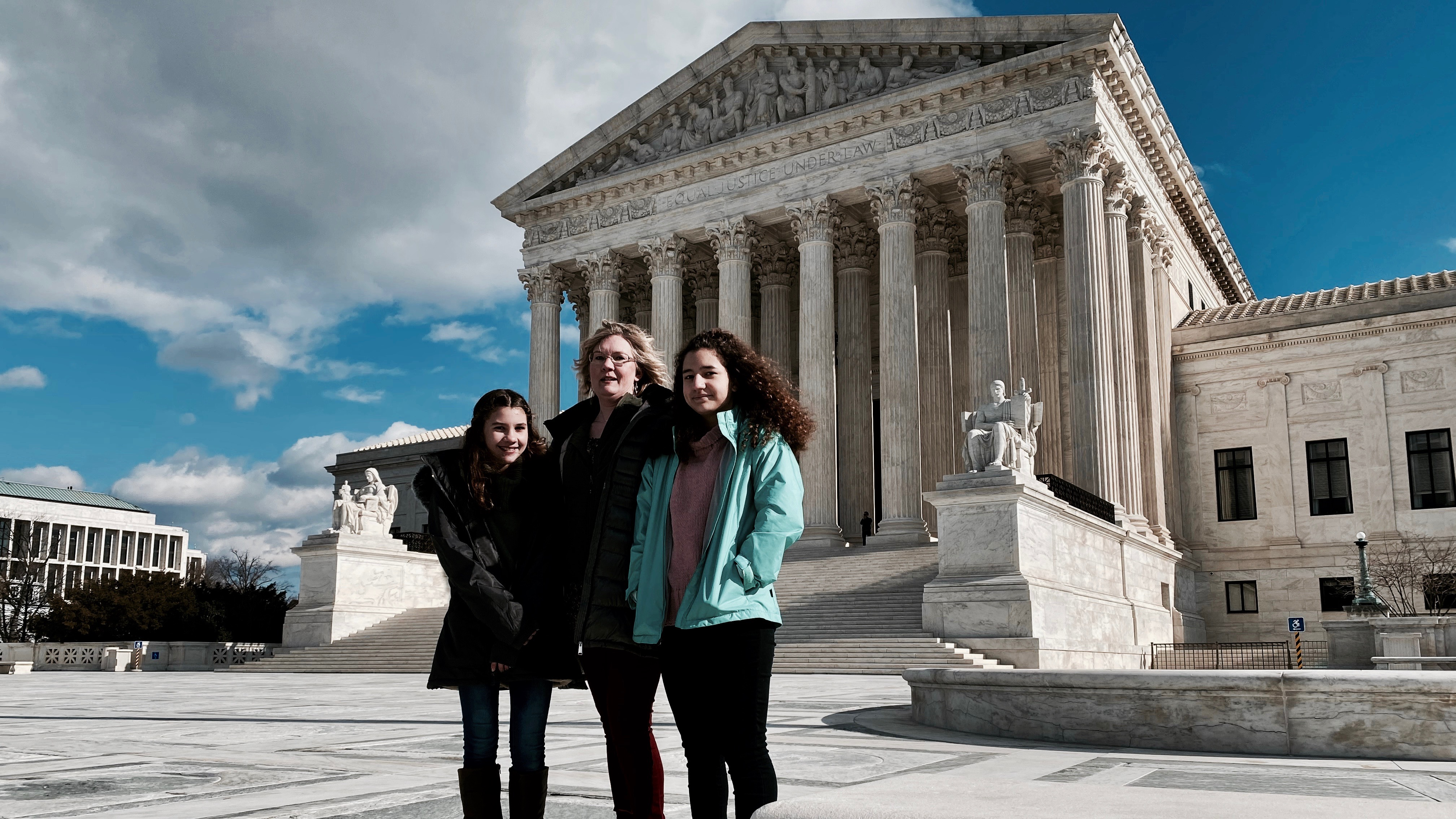Kendra Espinoza and her daughters in front of the US Supreme Court.