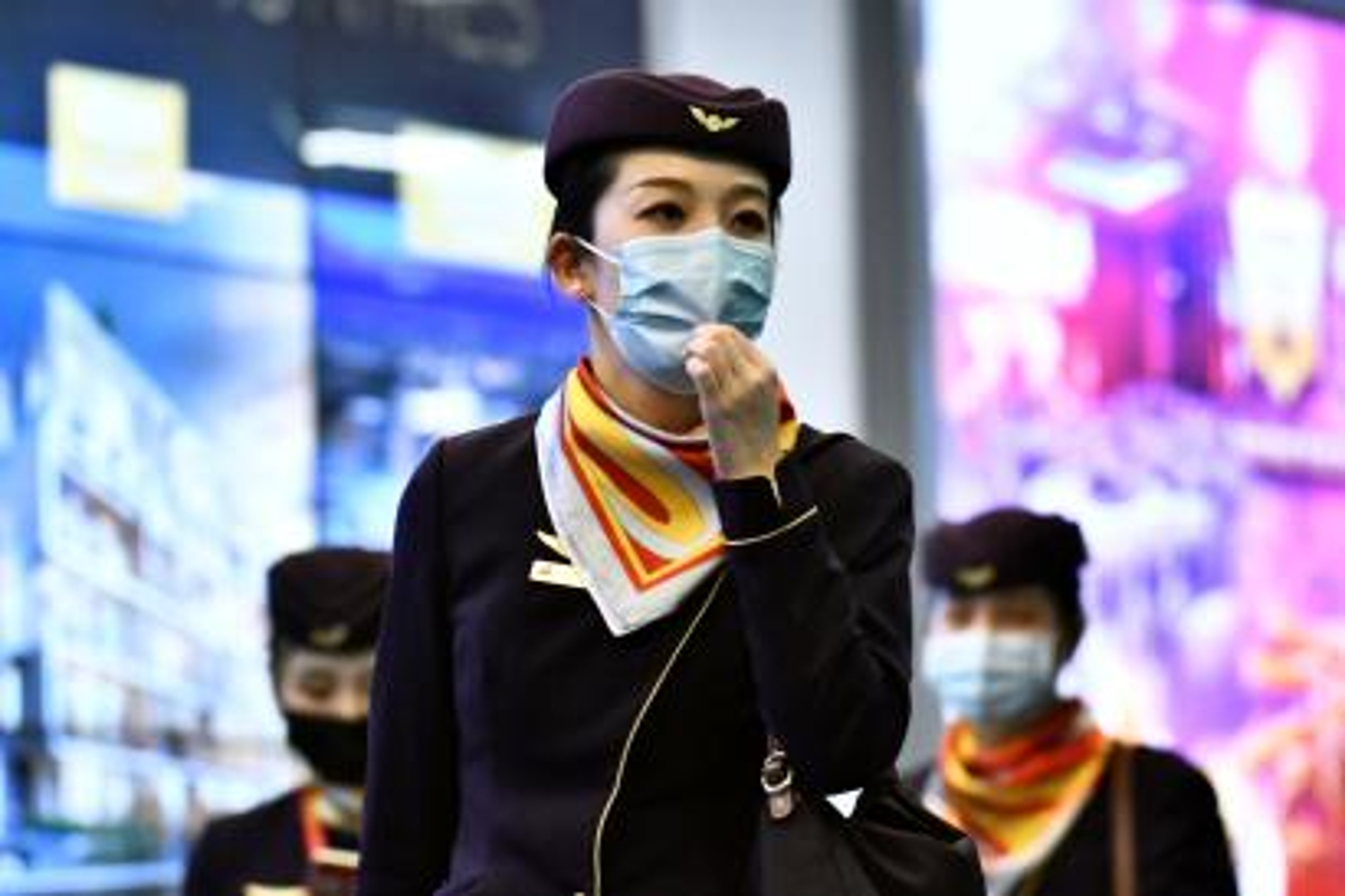Flight crew wearing face masks.