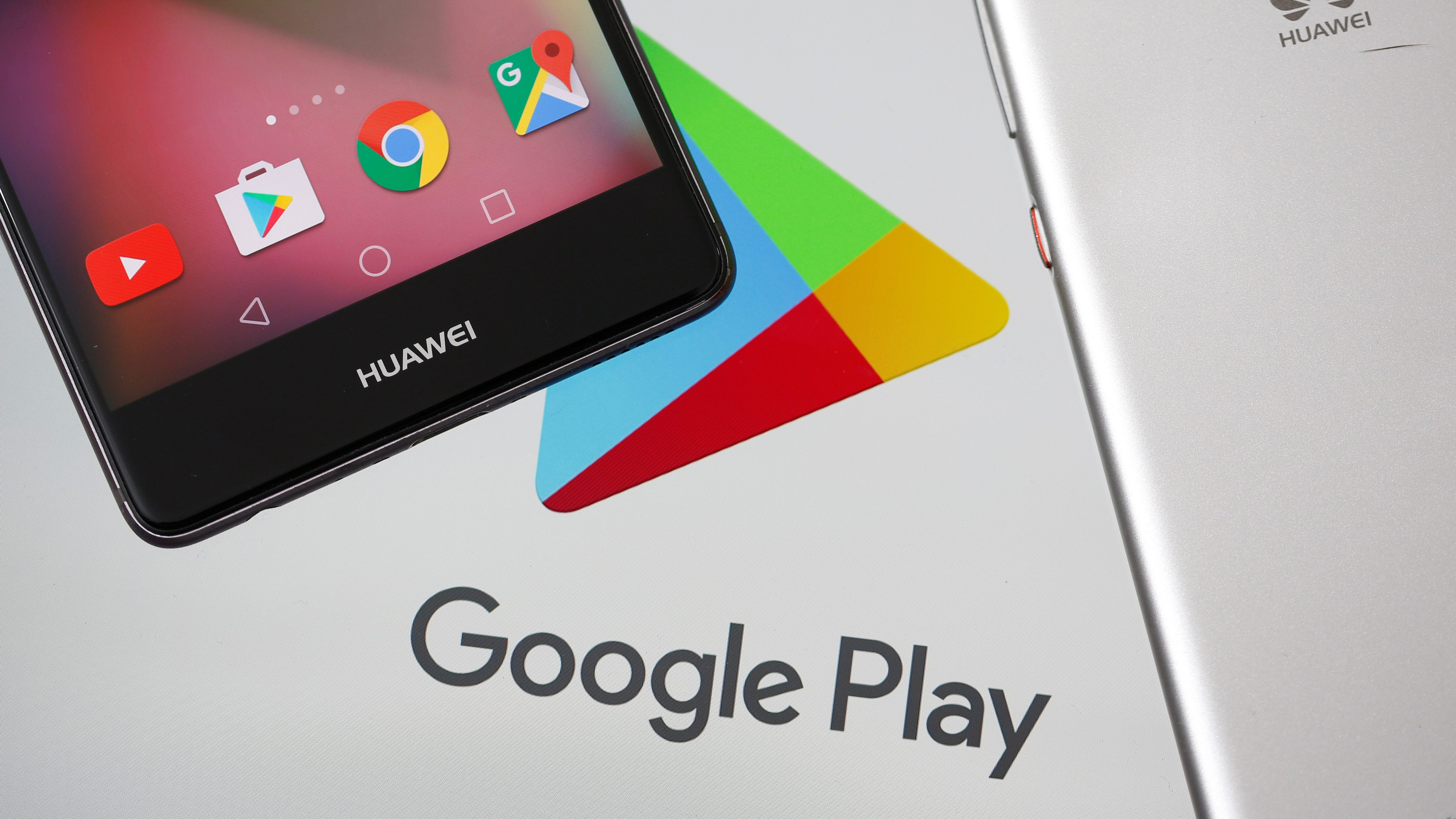 The Google Play logo by an Android smartphone