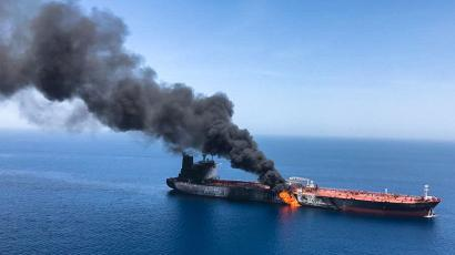 An oil tanker is on fire in the Gulf of Oman in June 2019.