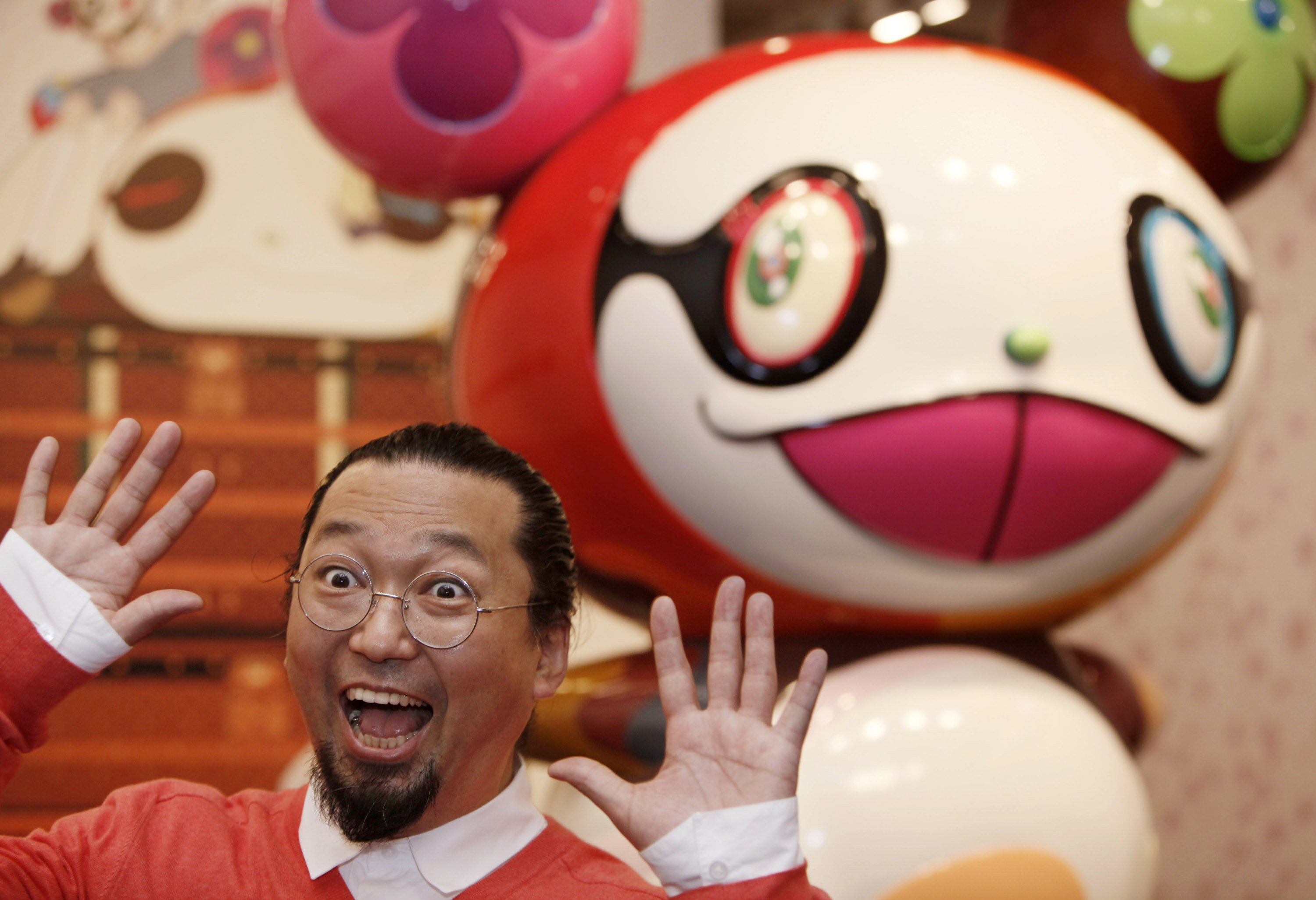 "Japanese artist Takashi Murakami poses in front of his creation ""Panda"" in 2009"