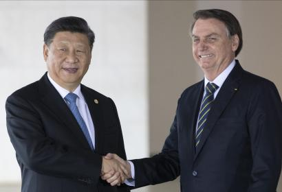 Brazilian president Jair Bolsonaro shakes hands with China's Xi Jinping