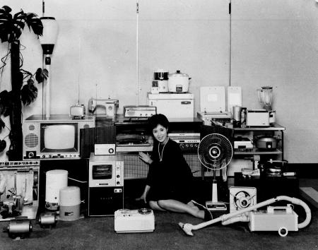 A model sits among the many different electrical appliances manufactured by the Mitsubishi Electric Co. in Japan