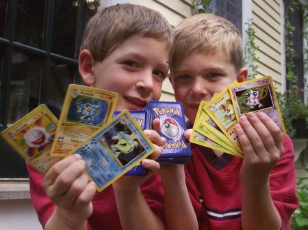 Tyler, right, and his friend George, both six of Scituate, Mass., hold up their favorite Pokemon trading cards, in Scituate, Thursday, Sept. 9, 1999.