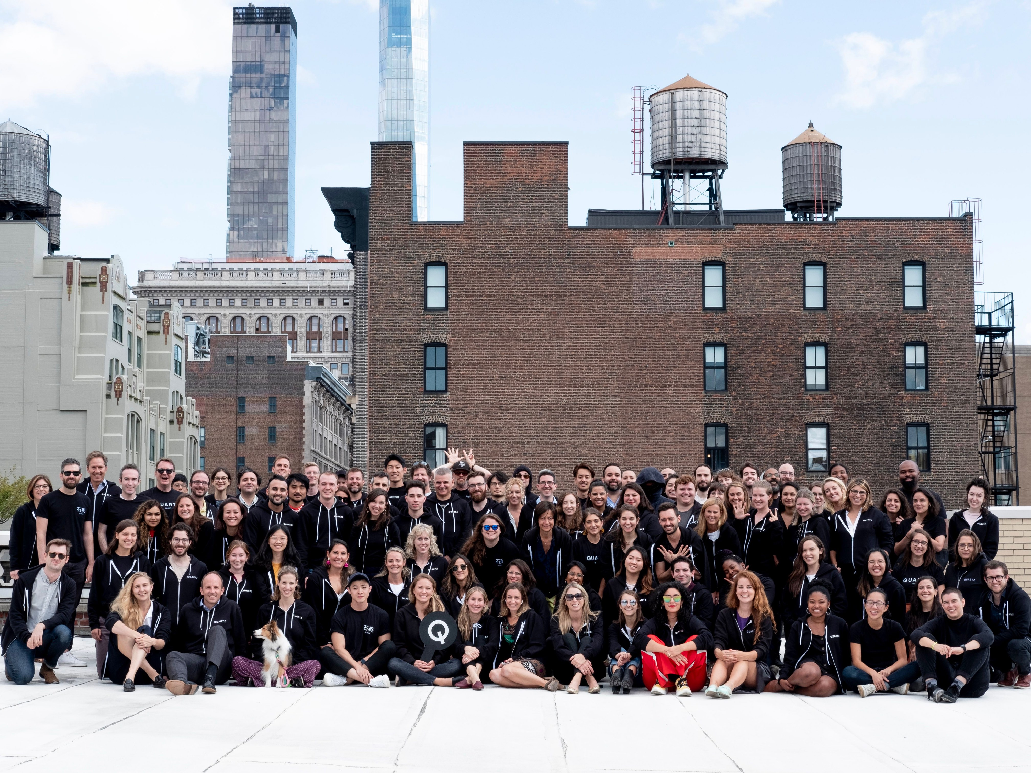 Our staff poses on the rooftop