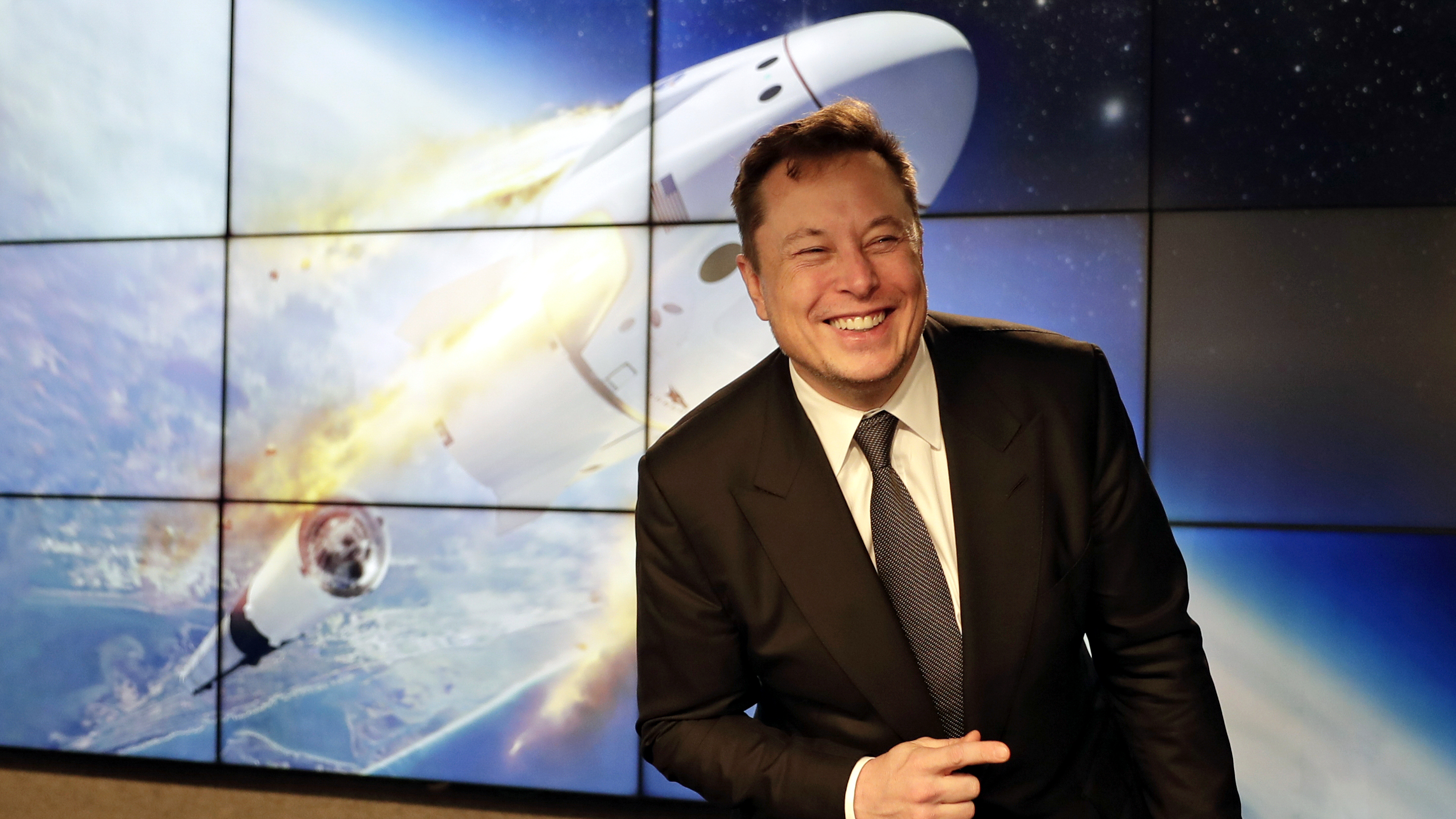 Elon Musk and the crew Dragon spacecraft.
