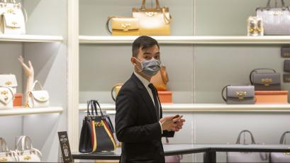 Shop assistants in luxury outlets in Sydney are seen wearing masks on January 31, 2020