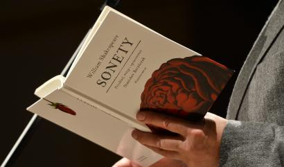 Lead image, hand holding book of poetry