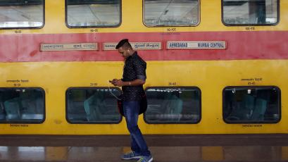 An Indian traveller uses Google Station.