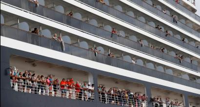 Passengers aboard the MS Westerdam prepare to disembark in Cambodia.