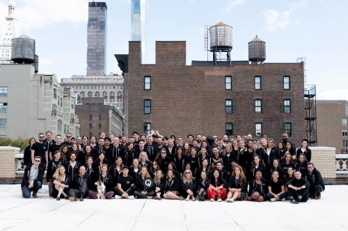 The Quartz staff pose for a class photo on the New York office rooftop