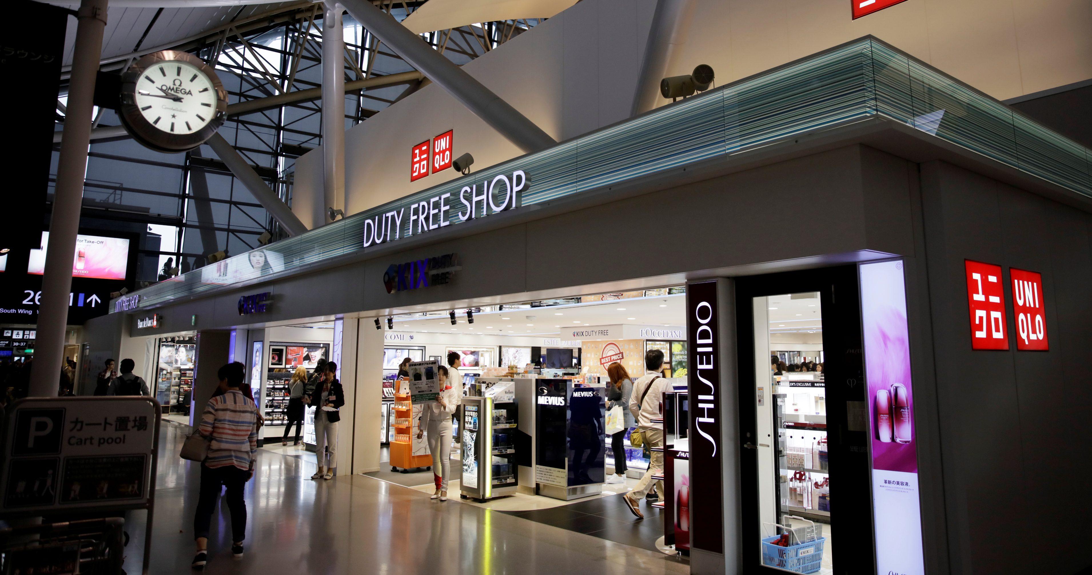 People shop at a UNIQLO store at Kansai International Airport in Osaka, Japan