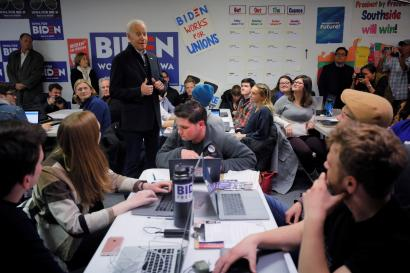 Democratic 2020 U.S. presidential candidate and former U.S. Vice President Joe Biden gives a thumbs up to volunteers phone-banking at his south side campaign office in Des Moines, Iowa, U.S., January 13, 2020.