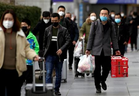 Street scene in China showing people wearing face masks, amid the coronavirus epidemic
