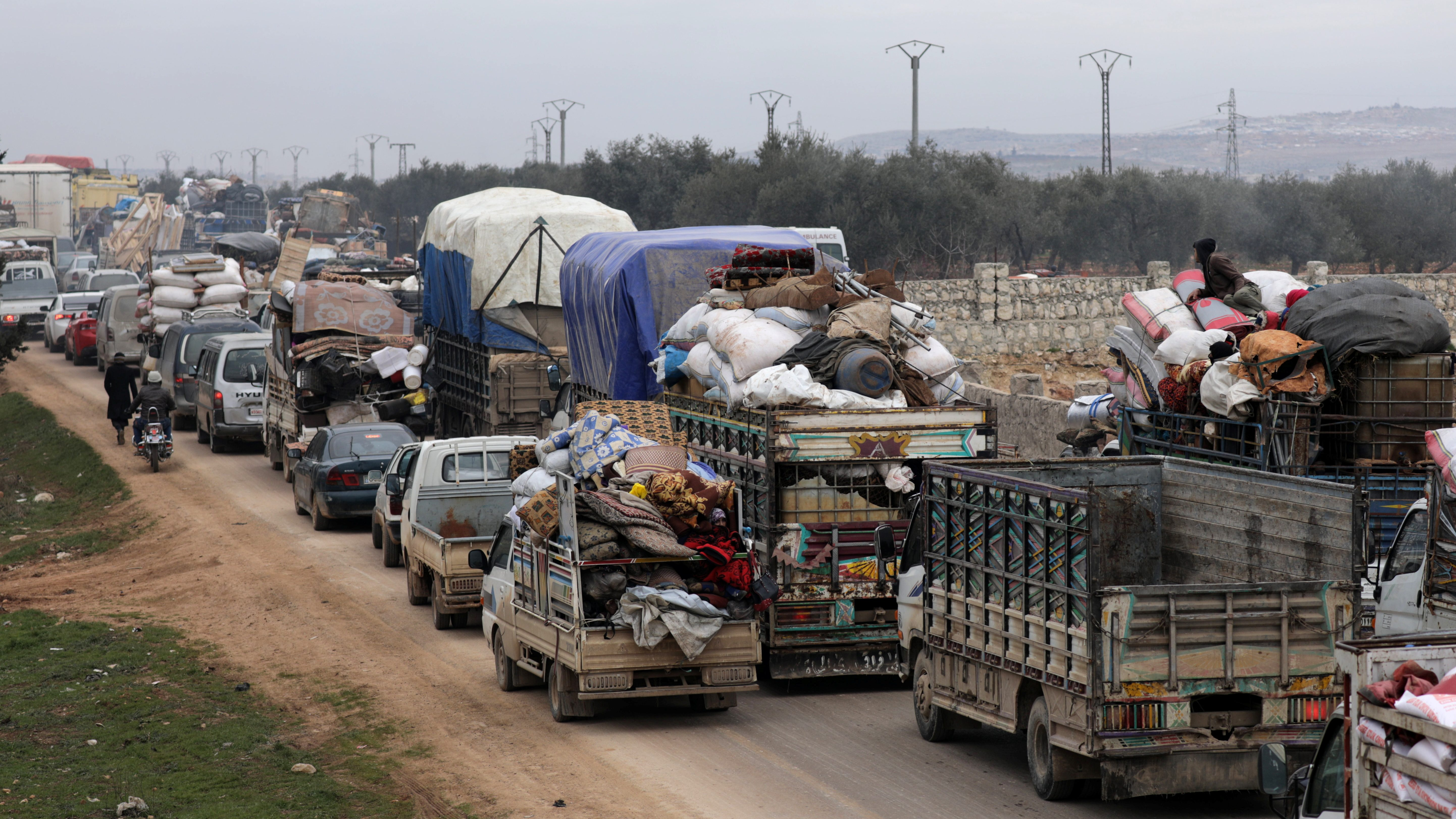 A general view of vehicles carrying belongings of internally displaced Syrians from western Aleppo countryside, in Hazano near Idlib, Syria, February 11, 2020.