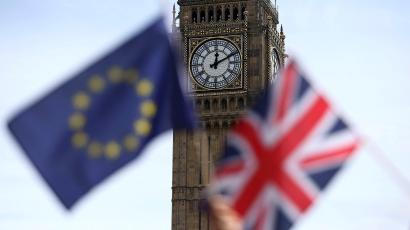Participants hold a British Union flag and an EU flag during a pro-EU referendum event at Parliament Square in London, Britain June 19, 2016.