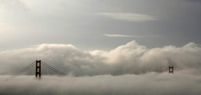 Fog envelops the Golden Gate Bridge in San Francisco, California.