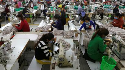 Garment workers at a factory in Cambodia sewing clothes for H&M