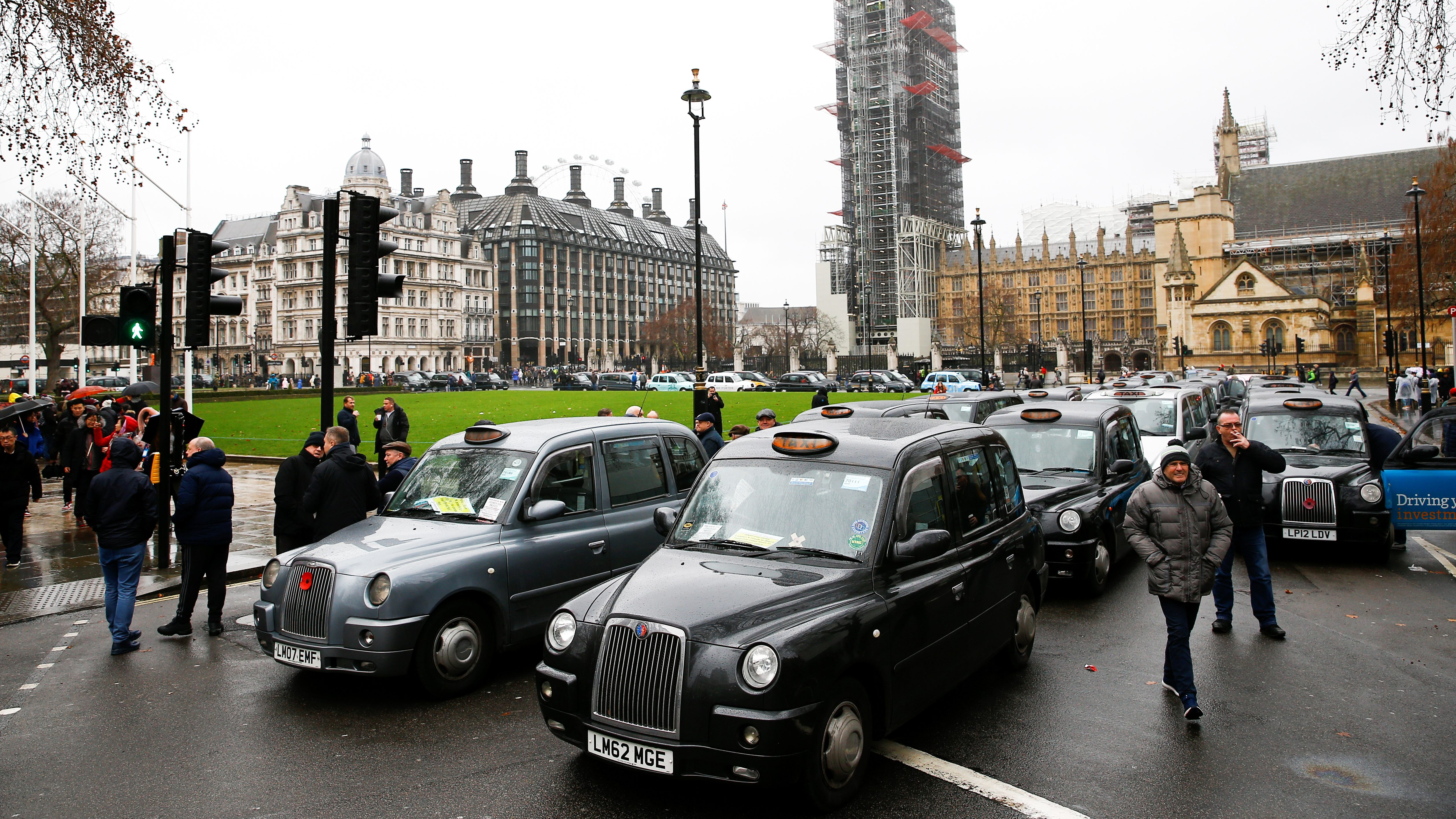 London taxi drivers stage a road block protest outside the Houses of Parliament, in central London