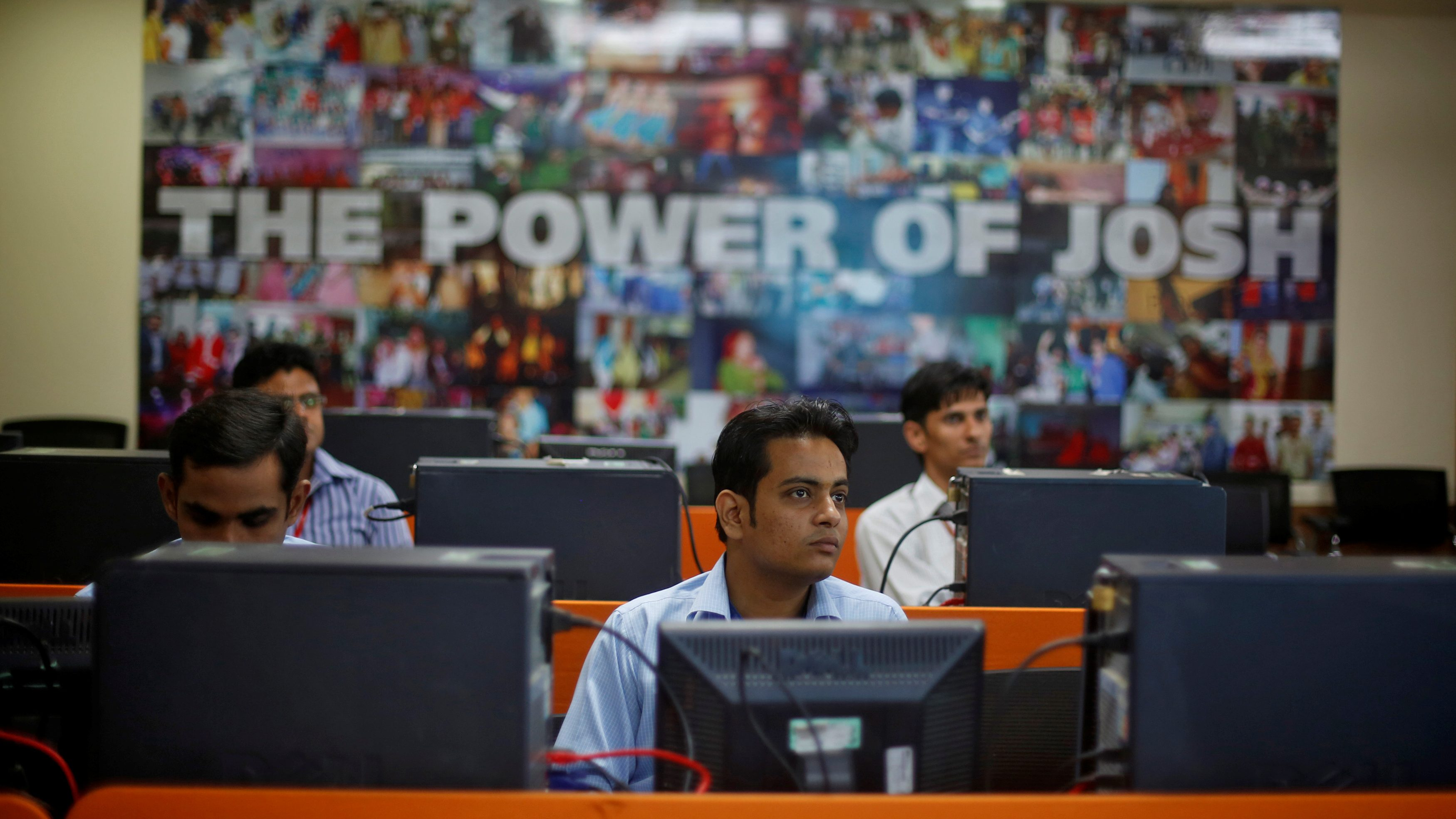 Newly recruited employees attend a training session inside Tech Mahindra office building in Noida