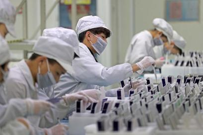Workers in factory in China.