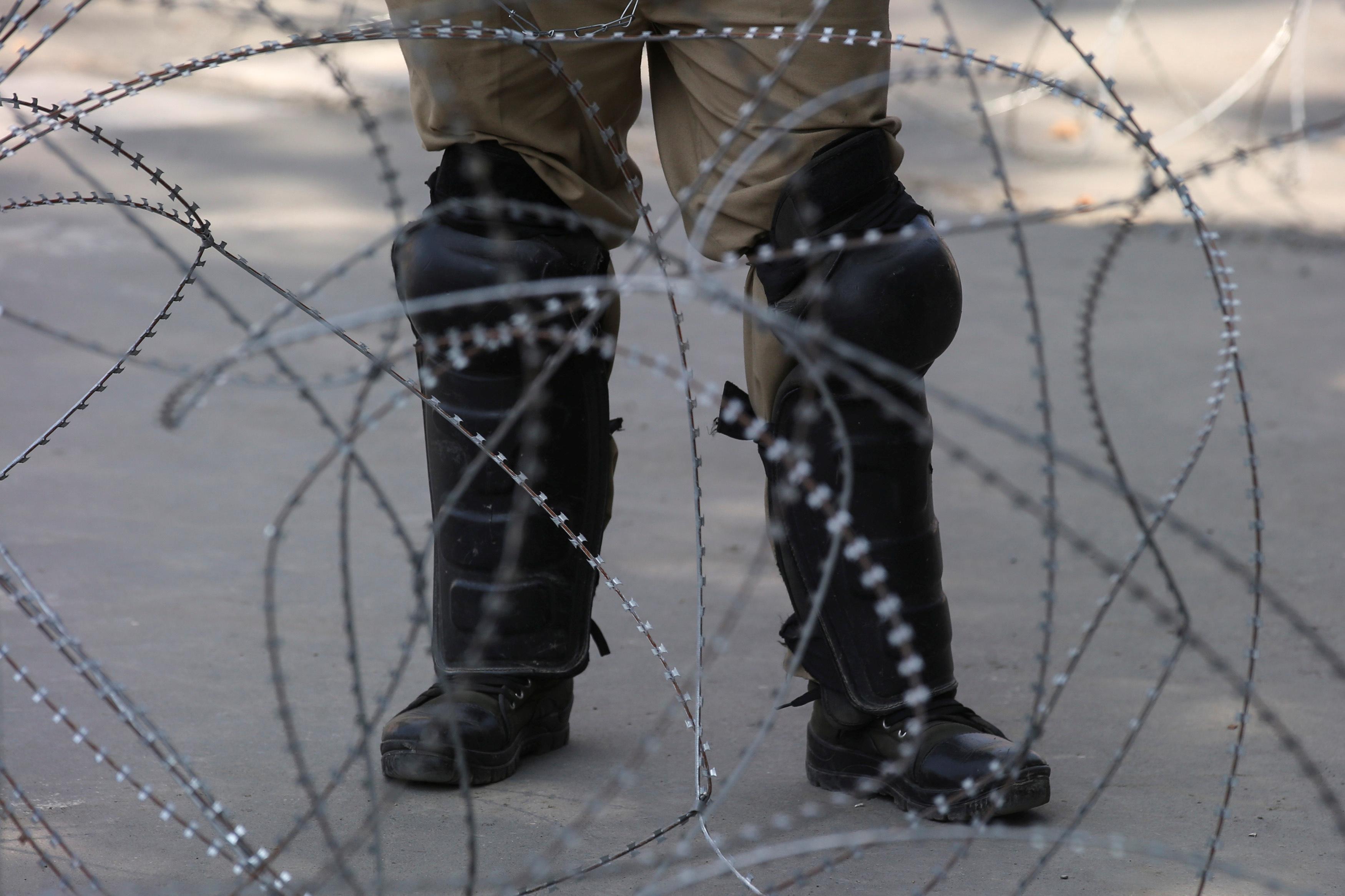 Indian police officer in Kashmir
