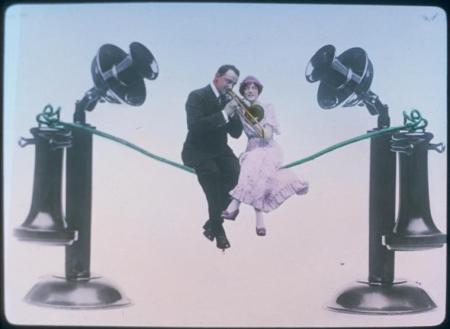 man and woman sitting on telephone wire