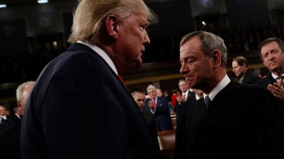 Donald Trump hovers over a pained-looking John Roberts.