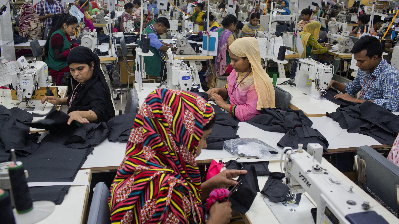 Bangladeshis work at a garment factory in Dhamrai, near Dhaka