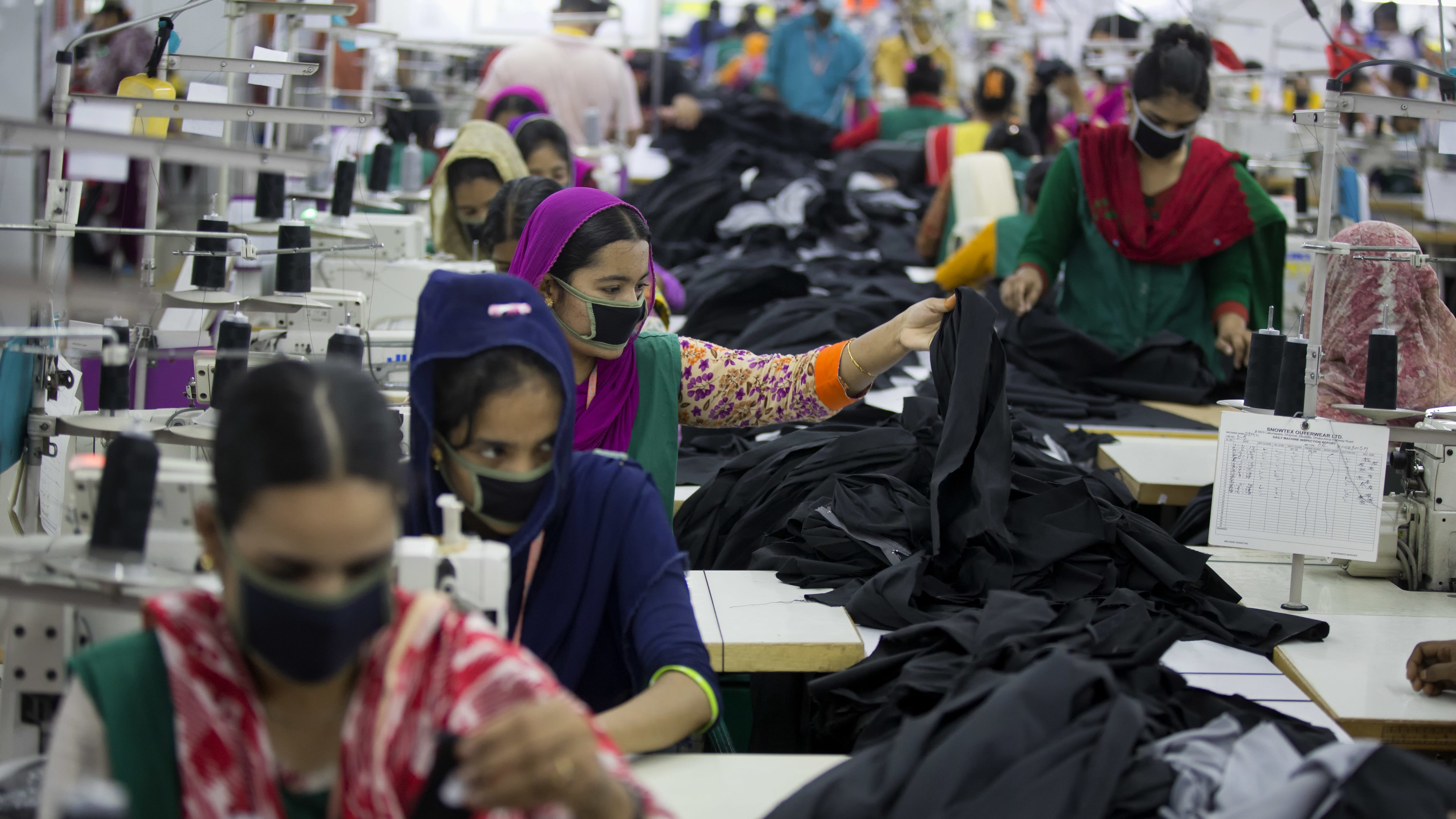 Bangladeshis work at a garment factory in Dhamrai, near Dhaka, Bangladesh