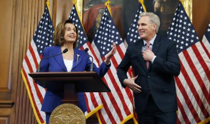 House Speaker Nancy Pelosi, a Democrat, and Rep. Kevin McCarthy, a Republican, participate in a bill enrollment ceremony for the Coronavirus Aid, Relief, and Economic Security (CARES) Act.