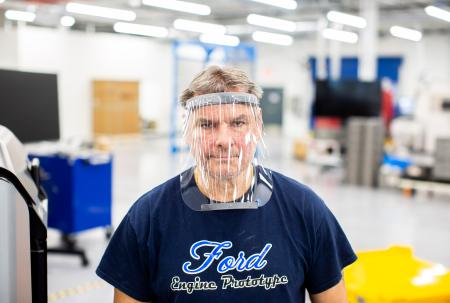 REDFORD, MI. Mar. 24, 2020 – Dave Jacek, 3D printing technical, wears a prototype of a 3D-printed medical face shield printed at Ford's Advanced Manufacturing Center. Ford Motor Company, joining forces with firms including 3M and GE Healthcare, is lending its manufacturing and engineering expertise to quickly expand production of urgently needed medical equipment and supplies for healthcare workers, first responders and patients fighting coronavirus.
