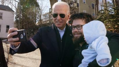 Democratic presidential candidate and former Vice President Joe Biden greets a man with his baby after a campaign event in Somersworth