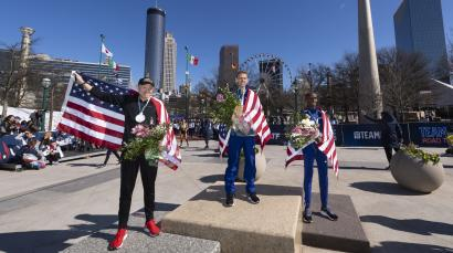 First place finisher Galen Rupp, center second place finisher Jacob Riley, left, and third place finisher Abdi Abdirahman stand on on the medal stand in Centennial Olympic Park after running in the U.S. Olympic marathon trials, Saturday, Feb. 29, 2020, in Atlanta
