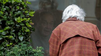 Gene Campbell talks through a window with his wife of more than 60 years, Dorothy Campbell, at the Life Care Center of Kirkland, the long-term care facility linked to several confirmed coronavirus cases in the state, in Kirkland