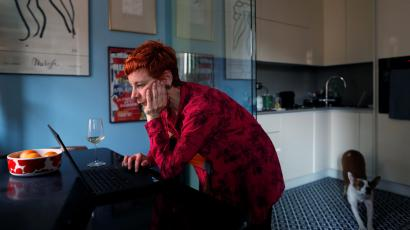 Francesca Valagussa, 40, works at her home at lunchtime, in Rome