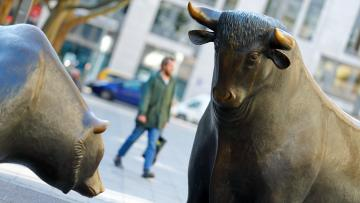 Bull and bear, symbols for successful and bad trading are seen in front of the German stock exchange (Deutsche Boerse), as markets react on the coronavirus disease (COVID-19) in Frankfurt, Germany, March 25, 2020.